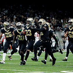 Dec 24, 2017; New Orleans, LA, USA; New Orleans Saints cornerback Marshon Lattimore (23) celebrates with teammates after a interception against the Atlanta Falcons during the second quarter at the Mercedes-Benz Superdome. Mandatory Credit: Derick E. Hingle-USA TODAY Sports