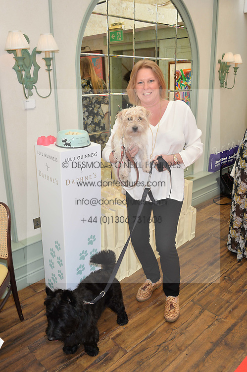 VISCOUNTESS GORMANSTON and her dog Otis and Doris Beddow at a party hosted by Lulu Guinness and Daphne's to launch Lulu's Designer Dog Bowl and to mark Daphne's allowing dogs through it's doors, held at Daphne's, Draycott Avenue, London on 28th June 2016.