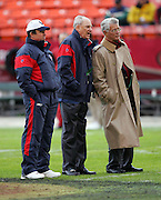 SAN FRANCISCO - JANUARY 1:  (Left to right) Houston Texans Head Coach Dom Capers, Chairman and CEO Robert C. McNair, and team consultant Dan Reeves on the field during pregame warmups against the San Francisco 49ers at Monster Park on January 1, 2006 in San Francisco, California. The Niners defeated the Texans 20-17 in overtime. ©Paul Anthony Spinelli *** Local Caption *** Dom Capers;Robert C. McNair;Dan Reeves