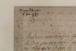 """The last letter of Mary Queen of Scots written just six hours before her execution is on public display at the National Library of Scotland on the 430th anniversary of her death.<br /> <br /> The letter was written at 2am on 8 February 1857 as Mary prepared to meet her death at Fotheringay Castle. Writing to Henri III, King of France, the brother of her first husband, she says """"I am to be executed like a criminal at eight in the morning"""".<br /> <br /> Pictured: The seal at the top of the letter"""