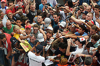 Lewis Hamilton (GBR) Mercedes AMG F1 signs autographs for the fans.<br /> Italian Grand Prix, Thursday 4th September 2014. Monza Italy.