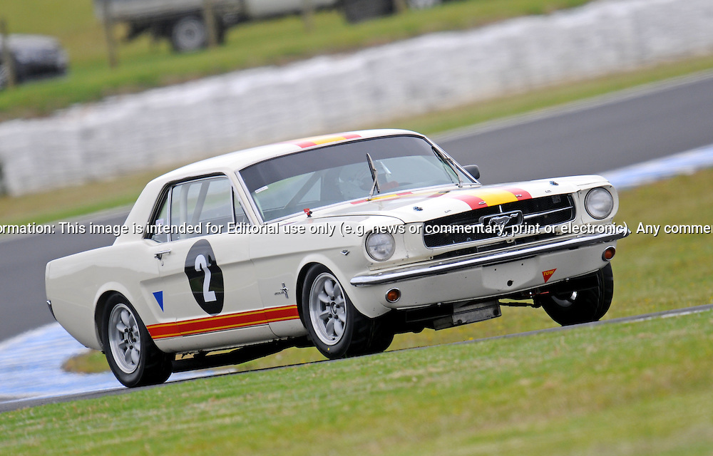 Grant Bingley - Ford Mustang.Historic Motorsport Racing - Phillip Island Classic.18th March 2011.Phillip Island Racetrack, Phillip Island, Victoria.(C) Joel Strickland Photographics.Use information: This image is intended for Editorial use only (e.g. news or commentary, print or electronic). Any commercial or promotional use requires additional clearance.