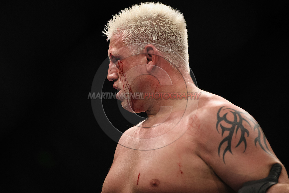 "SYDNEY, AUSTRALIA, FEBRUARY 27, 2011: Blood streams from a cut above Chris Tuchscherer's eye during ""UFC 127: Penn vs. Fitch"" inside Acer Arena in Sydney, Australia on February 27, 2011."