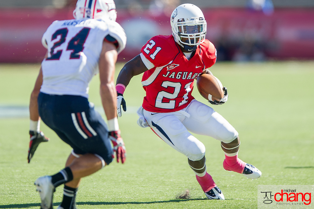MOBILE, AL - OCTOBER 20:  Running back Terrance Timmons #21 of the South Alabama Jaguars looks to maneuver around safety Brent Harstad #24 of the Florida Atlantic Owls on October 20, 2012 at Ladd-Peebles Stadium in Mobile, Alabama. South Alabama defeated Florida Atlantic in the second overtime 37-34.  (Photo by Michael Chang/Getty Images) *** Local Caption *** Terrance Timmons;Brent Harstad