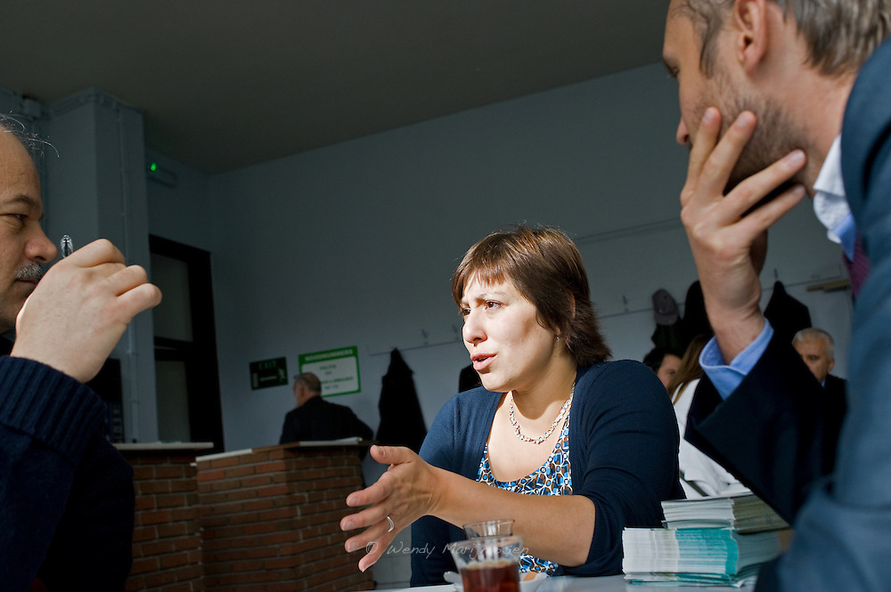 Meyrem Almaci answers questions and discuss political issues with men in the cafeteria of the mosque before the friday prayer. Antwerpen, Belgium, 2012