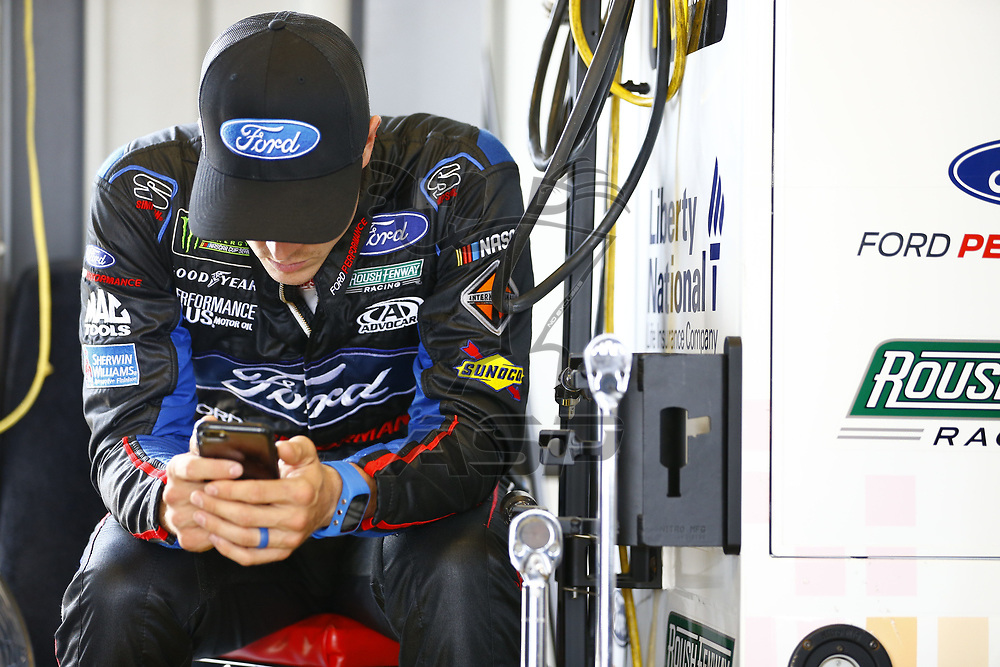July 07, 2017 - Sparta, KY, USA: Trevor Bayne (6) hangs out in the garage during practice for the Quaker State 400 at Kentucky Speedway in Sparta, KY.