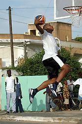 DAKAR - SEPTEMBER 17: Boris Diaw, captain of France national basketball team and NBA player in Phoenix runs a  three-day basketball training workshop, on September 17, 2006 in Dakar, Senegal. (Photo by Aliou Mbaye/Panapress) *** Local Caption *** DAKAR -17 SEPTEMBRE: Boris Diaw, capitaine de l'equipe nationale de France de basket, societaire des Phoenix en NBA, anime un camp de basket pendant tois jours au centre de Bopp. Dakar, Senegal, 17 septembre 2006. (Photo Aliou Mbaye/Panapress)