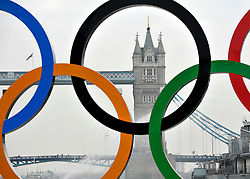 © Licensed to London News Pictures. 28/02/2012, London, UK. Tower Bridge in London is raised today 28 February to allow giant Olympic rings measuring 11 metres high by 25 metres wide are floated down the River Thames on a barge, marking 150 days to go to the start of the London 2012 Olympic and Paralympic Games. Photo credit : Stephen Simpson/LNP