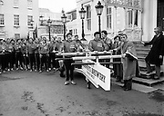 Some of the thirty-two firemen who raised money for UNICEF by pushing a fire-fighting pump from Dublin to Cork. Here they are being seen off at the Mansion House by the Lord Mayor.<br />