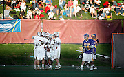 SHOT 5/11/13 7:09:16 PM - University of Denver players celebrate after a goal against the University at Albany during their first round NCAA Tournament lacrosse game at the Peter Barton Lacrosse Stadium on the University of Denver campus Saturday May 11, 2013. The University of Denver won the game 19-14 to advance. (Photo by Marc Piscotty / © 2013)