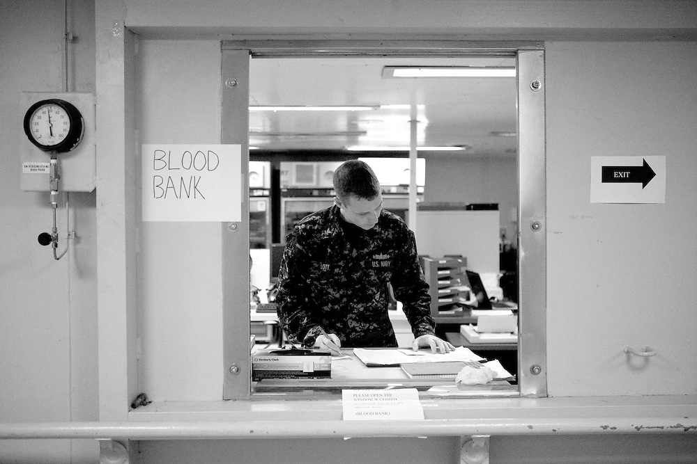 HM2 Gordon Lott tends the blood bank window on board the USNS Comfort, a U.S. Naval hospital ship, on January 21, 2010 in Port-au-Prince, Haiti. The Comfort deployed from Baltimore with 550 medical personnel on board to treat victims of Haiti's recent earthquake, and arrived on January 20.