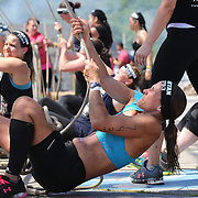 Competitors in action at the Herculean Hoist obstacle during the Reebok Spartan Race. Mohegan Sun, Uncasville, Connecticut, USA. 28th June 2014. Photo Tim Clayton
