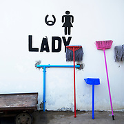 Myanmar (Burma). Bus trip Bagan to Inle lake. Toilet sign with cleaner's mops.