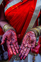 Woman's hands painted with henna dye (Mehndi), Chhadi Mar Holi (local Holi celebration), Holi Festival (Festival of Colors), village of Gokul, near Mathura, Uttar Pradesh, India.