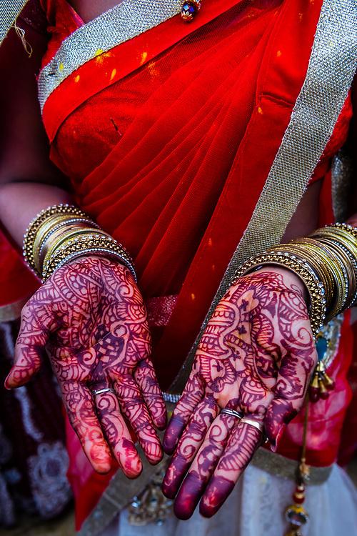 Woman's hands painted with henna dye (Mehndi), Chhadi Mar Holi (local Holi celebration), Holi Festival (Festival of Colors), village of Gokul, near Mathura, Uttar Pradesh, India.