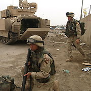 29 April 2004....Baghdad, Iraq.....US troops in Sadr city.....Troops from 2 Cav have the responsibility for patroling the streets of Baghdads most violent nieghbourhood, Sadr city...The residents are amoung Baghdads poorest with a high level of unemployment, the firebrand cleric Moqtada al Sadr has great support in this area and it has recently been the scene of violent clashes. His followers took over several buildings and the US forces have fought to regain control...The soldiers report that they are attacked nightly with riflefire, rocket propelled grenades and mortars.