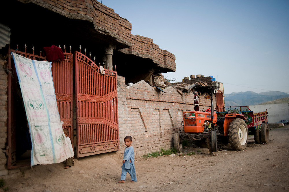 A small child walks outside the front home nearby the former compound of Osama Bin Laden in Abbottabad, Khyber Pakhtunkhwa province, Pakistan on May 5, 2011. US special forces launched an agressive attack on the compound early morning on May 2 killing Osama bin Laden.