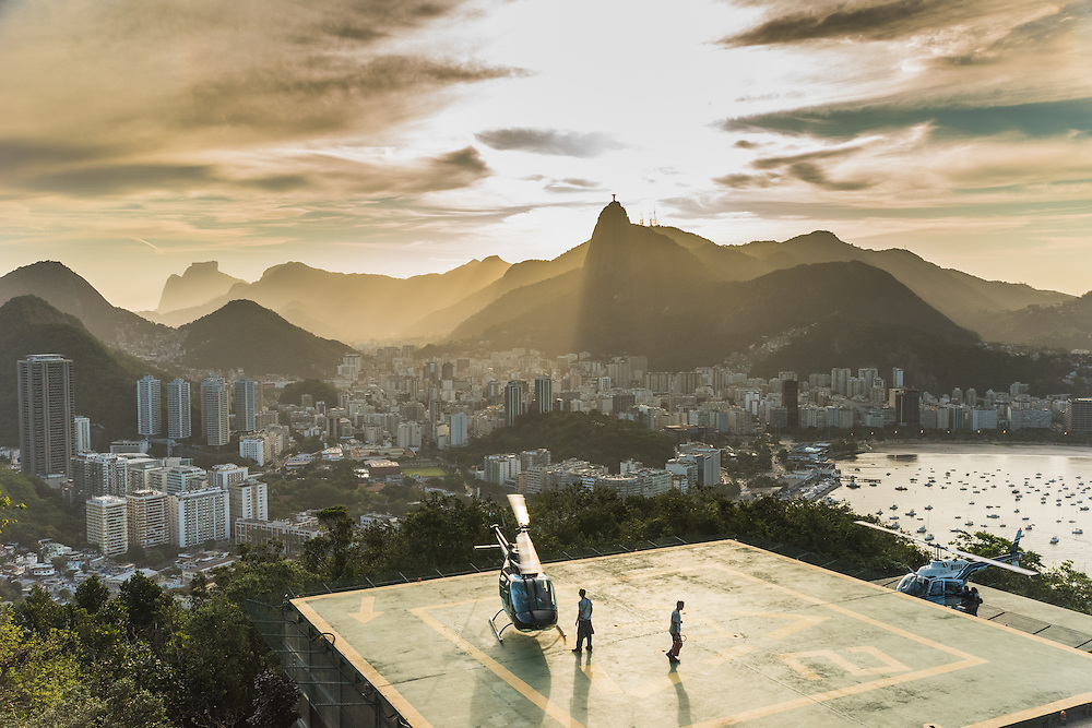 Helikopter platform and the city of Rio de Janeiro, seen from the Sugarloaf mountain at sunset, Brazil.