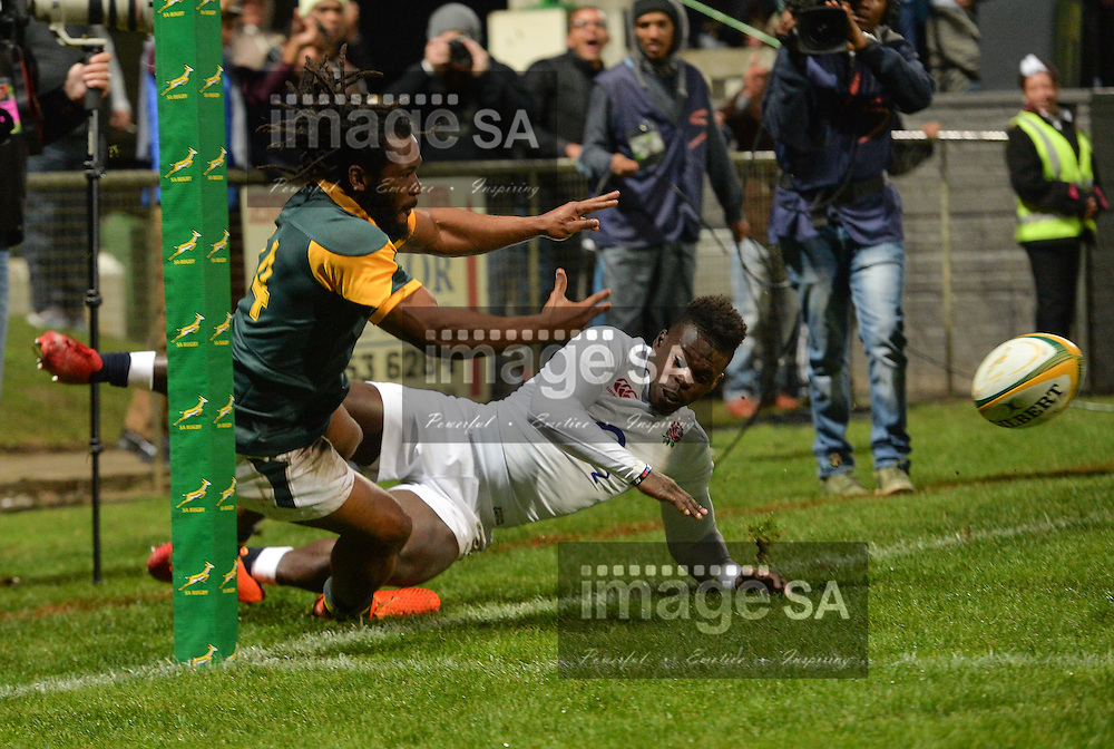 GEORGE, SOUTH AFRICA - JUNE 17: Sergeal Petersen of South Africa is forced into touch by Christian Wade of England during the match between South Africa 'A' and England Saxons at Outeniqua Park on June 17 2016 in George, South Africa. (Photo by Roger Sedres/Gallo Images)