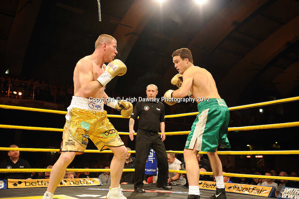 Joe Rea (gold shorts) defeats Simon O'Donnell in Quarter Final Four at Prizefighter Middleweights, Kings Hall, Belfast, Northern Ireland on 5th May 2012. Promoted by Prizefighter/Matchroom Sport. © Leigh Dawney Photography 2012.