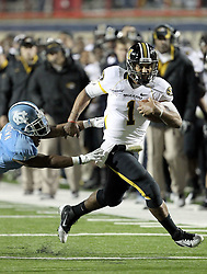 Missouri quarterback James Franklin (1) runs away from North Carolina Charles Brown (12) during the first quarter of their Independence Bowl college football game in Shreveport, La., Monday, Dec. 26, 2011.