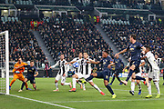 Manchester United Forward Anthony Martial battles with Juventus Forward Cristiano Ronaldo and shoots at goal during the Champions League Group H match between Juventus FC and Manchester United at the Allianz Stadium, Turin, Italy on 7 November 2018.