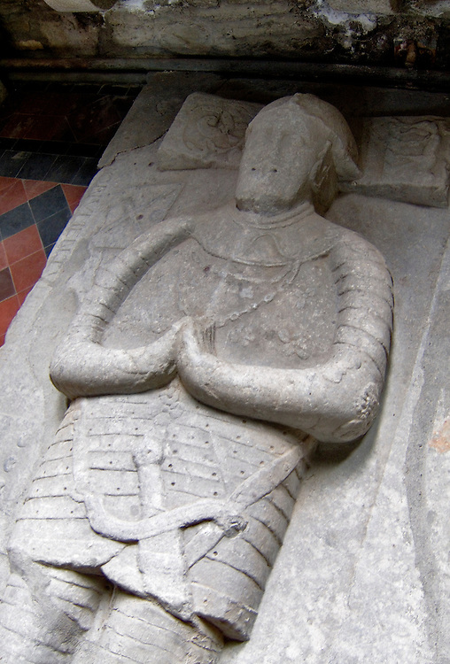 Effigy of a Knight on stone carved sarcophagus tomb inside St. Brigid's Cathedral, County Kildare, Ireland