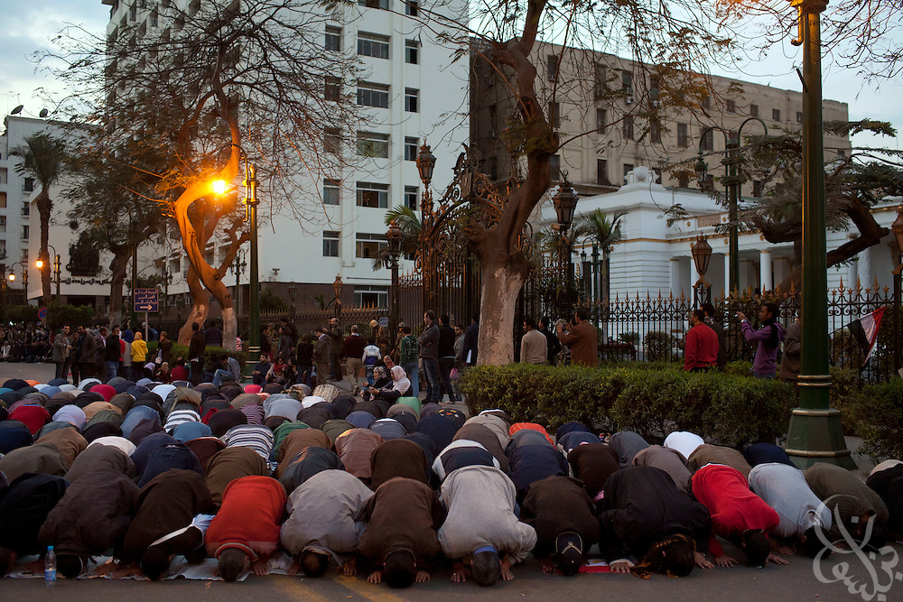 Egyptian protesters pray during a protest outside the gates of the Parliament building February 08, 2011 in Cairo, Egypt. The numbers of protesters in and around Tahrir swelled again today after a few days where it seemed momentum had been lost and the crowds were thinning. .Slug: Egypt.(Photo by Scott Nelson)