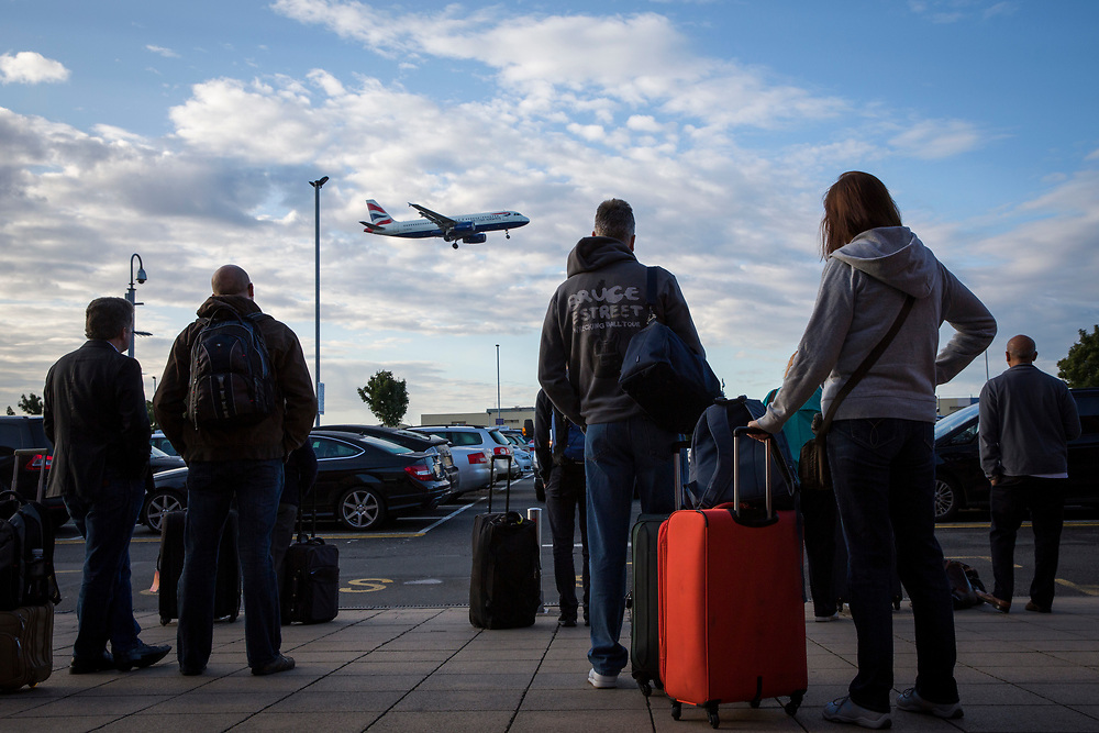 Travellers with their suitcases wait outside the Heathrow Premier Inn for the terminal shuttle bus to take them  to their required terminal at Heathrow airport.  (photo by Andrew Aitchison / In pictures via Getty Images)