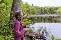 A woman birdwatching at the Orris Falls Preserve in South Berwick, Maine.