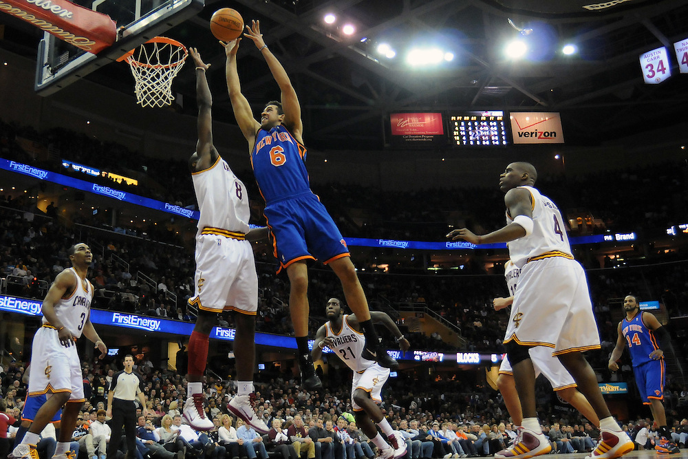 Feb. 25, 2011; Cleveland, OH, USA; New York Knicks guard Landry Fields (6) shoots over Cleveland Cavaliers guard Christian Eyenga (8) during the second quarter at Quicken Loans Arena. Mandatory Credit: Jason Miller-US PRESSWIRE