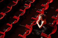 Woman sitting in theatre stalls high angle view