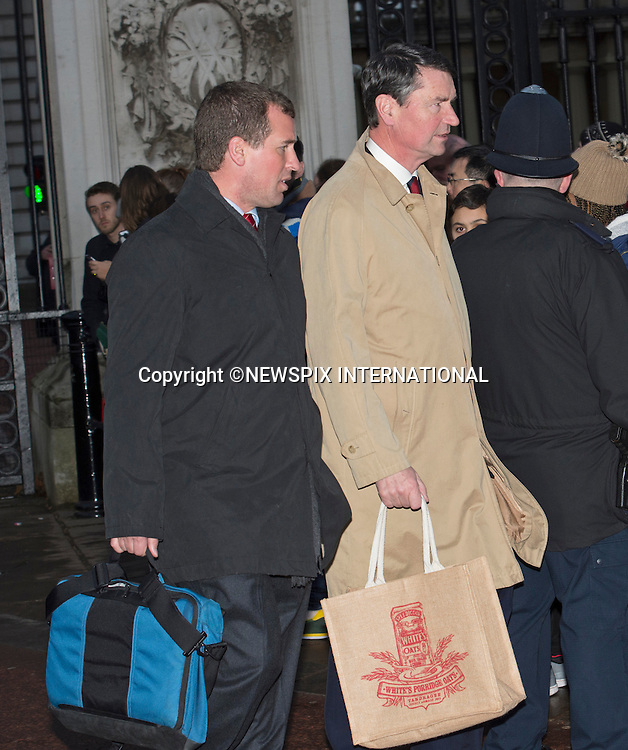 17.12.2014; London UK: PETER PHILLIPS AND TIM LAURENCE<br /> attend the Christmas lunch hosted by The Queen at Buckingham Palace.<br /> The annual lunch is held so the Queen can meet with the extended family, as Sandringham House can not accommodate them over Christmas.<br /> Prince George accompanied by Royal Nanny Maria Theresa Borrallo, joined members of the Royal Family after lunch.<br /> Royals present include Catherince, Duchess of Cambridge, Prince William, Prince Charles, Prince Harry, Princess Beatrice, Prince Edward; The Linleys, Chattos, Prince and Princess Michael of Kent, The Gloucesters.<br /> Mandatory Photo Credit: &copy;NEWSPIX INTERNATIONAL<br /> <br /> **ALL FEES PAYABLE TO: &quot;NEWSPIX INTERNATIONAL&quot;**<br /> <br /> PHOTO CREDIT MANDATORY!!: NEWSPIX INTERNATIONAL(Failure to credit will incur a surcharge of 100% of reproduction fees)<br /> <br /> IMMEDIATE CONFIRMATION OF USAGE REQUIRED:<br /> Newspix International, 31 Chinnery Hill, Bishop's Stortford, ENGLAND CM23 3PS<br /> Tel:+441279 324672  ; Fax: +441279656877<br /> Mobile:  0777568 1153<br /> e-mail: info@newspixinternational.co.uk