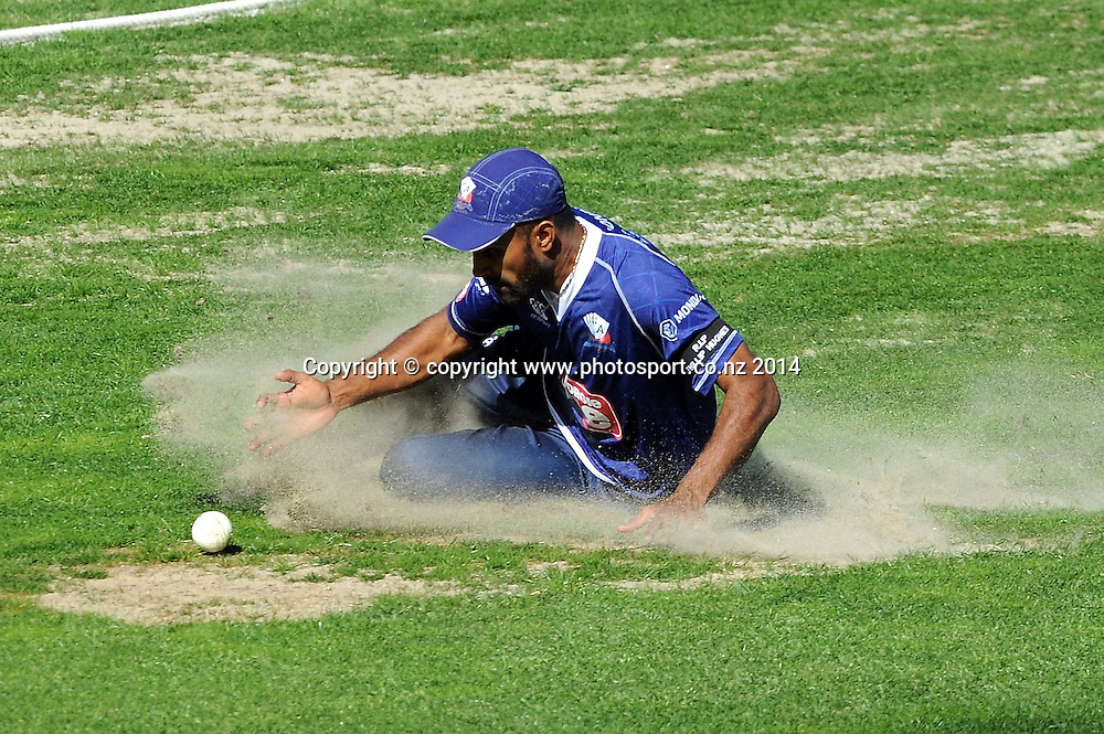 Auckland Ace's Tarun Nethula hits a sandy spot in the outfield during the Georgie Pie Super Smash T20 cricket match, Aces vs Kings, McLean Park, Napier, Saturday, November 29, 2014. Photo: Kerry Marshall / photosport.co.nz