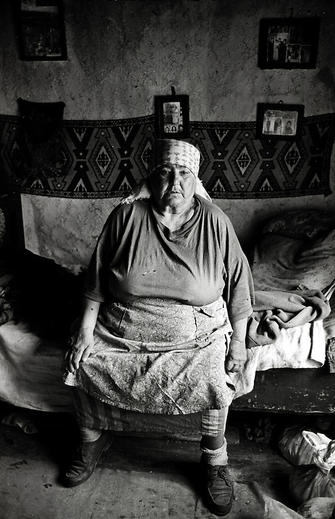 A Roma woman sits inside her tiny dwelling Pintic Transylvania Romania.David Dare Parker / Network Photographers