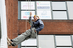 Fearless Hill Dickinson Partner Giles Searby stops for a photocall during the Plusnet and Hill Dickinson Charity Abseil 111 feet down the Balance building in Sheffield to raise money for Roundabout and Saint Lukes Hospice on Wednesday <br /> <br /> 11 June 2013<br /> Image © Paul David Drabble<br /> www.pauldaviddrabble.co.uk