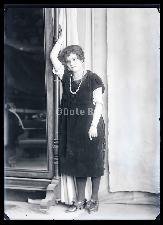 full length portrait of a woman leaning casually France circa 1920s