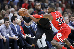 December 4, 2017 - Chicago, IL, USA - Chicago Bulls guard Kris Dunn (32) guards Cleveland Cavaliers guard Dwyane Wade (9) during the first half on Monday Dec. 4, 2017 at the United Center in Chicago, Ill. (Credit Image: © Armando L. Sanchez/TNS via ZUMA Wire)