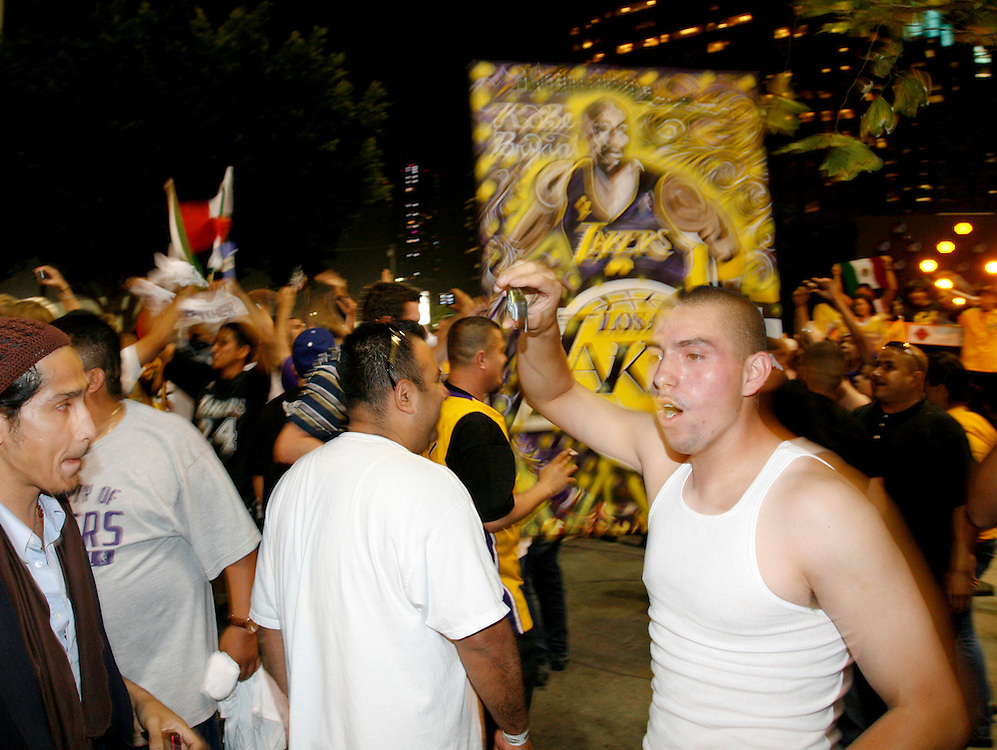 Fans of the Los Angeles Lakers celebrate their victory in the 2010 NBA Finals Championship against the Boston Celtics near the Staples Center in Los Angeles California, USA, 17 June 2010.