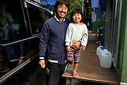 Mr Sakuji ARAKI, 42, with his daughter Kanaka, 3 (夏南風), in front of their home. He is a professional diver and built by himself his house next to the beach. <br /> <br /> He lives in the village of Abu, located next to Henoko, on the North East side of Oura bay, where an U.S.-operated Osprey crashed into the sea last December, injuring its crew of five after a hose connected to the aircraft broke during a refueling exercise. <br /> <br /> He's been since then cleaning the sea floor of the numerous small pieces of the aircraft with a group of volunteers. <br /> <br /> As he makes a living from the sea he worries about the environmental impact of the new Henoko base and the permanent damage the coral reefs.<br /> He also explains how the money coming from the U.S. bases over the past decades has made Okinawa people dependent. <br /> <br /> The Osprey aircraft has become a lightning rod for opposition to the U.S. military presence in Okinawa, with local groups seeking the closure of American bases saying it is prone to crash and poses a danger to residents.
