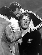 All Blacks Michael Speight receives some attention on his shoulder. Rugby union, Date unkonwn. Photographer unknown.