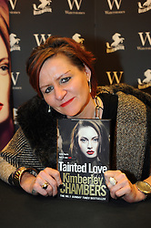 """© Licensed to London News Pictures. 20/02/2016<br /> Kimberley Chambers with her new book """" Tainted Love"""".<br /> Crime ficton author Kimberley Chambers at Waterstones book store Bluewater,Greenhithe,Kent.<br />  (Byline:Grant FalveyLNP)"""