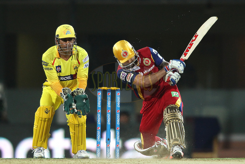 Royal Challengers Bangalore captain Virat Kohli hits over the top for six during match 37 of the Pepsi IPL 2015 (Indian Premier League) between The Chennai Superkings and The Royal Challengers Bangalore held at the M. A. Chidambaram Stadium, Chennai Stadium in Chennai, India on the 4th May April 2015.<br /> <br /> Photo by:  Shaun Roy / SPORTZPICS / IPL