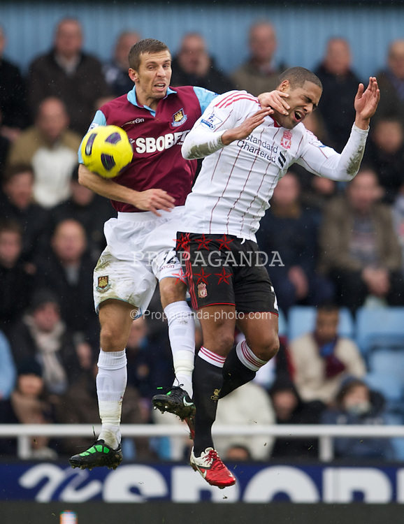 LONDON, ENGLAND - Sunday, February 27, 2011: Liverpool's Glen Johnson and West Ham United's Gary O'Neil during the Premiership match at Upton Park. (Photo by David Rawcliffe/Propaganda)