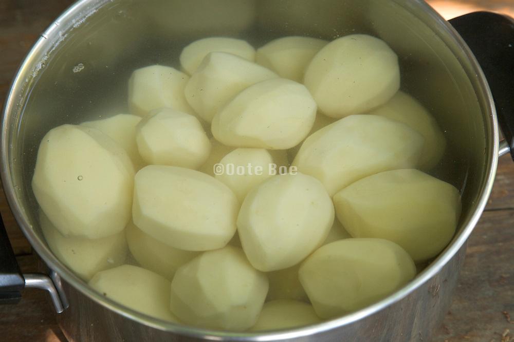 pan with peeled potatoes