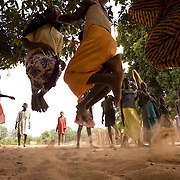 Girls skip rope outside the Colomba primary school in the town of Colomba, Senegal on Tuesday June 12, 2007.