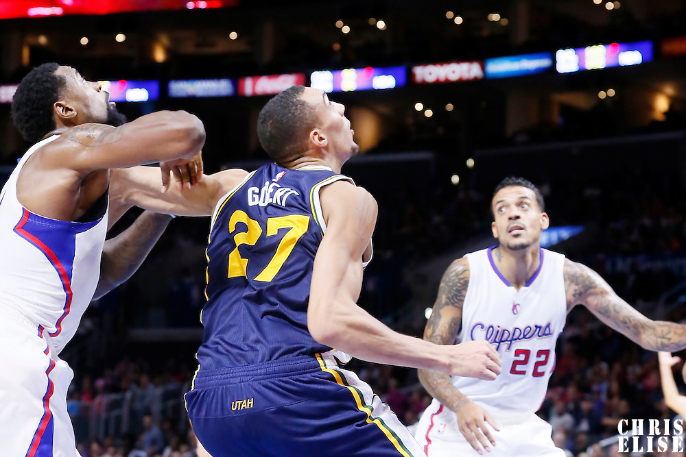 17 October 2014: Utah Jazz center Rudy Gobert (27) vies for the rebound with Los Angeles Clippers center DeAndre Jordan (6) during the Los Angeles Clippers 101-97 victory over the Utah Jazz, in a preseason game, at the Staples Center, Los Angeles, California, USA.