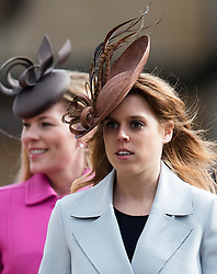 WINDSOR - UK - 27th Mar 2016: HM Queen Elizabeth, accompanied by HRH The Duke , The Duke and members of the royal family attends the annual Easter Sunday service at St George's Chapel in the grounds of Windsor Castle.<br /> Autumn Phillips, Princess Beatrice.<br /> Photograph by Ian Jones.