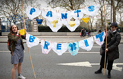 © Licensed to London News Pictures. 23/03/2019. London, UK. Protestors carry their message on underpants as they join thousands of demonstrators taking part in the 'Put It To The People march' through central London. The People's Vote Campaign are calling for a second referendum on the United Kingdom's membership of the European Union. Photo credit: Peter Macdiarmid/LNP