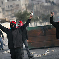 02/01/2009. Clashes in east Jerusalem.....Palestinian protesters throw stones during clashes with Israeli troops in East Jerusalem, as they demonstrate against Israel's military operation in Gaza, January 02, 2008. Photo by Michal Fattal. ..